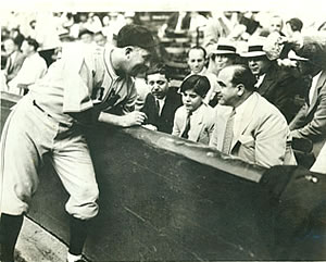 Al Capone with his son and lawyer being greeted by the Cubs' Gabby Hartnett